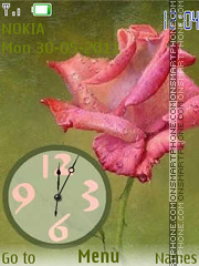 Rose analog Clock es el tema de pantalla
